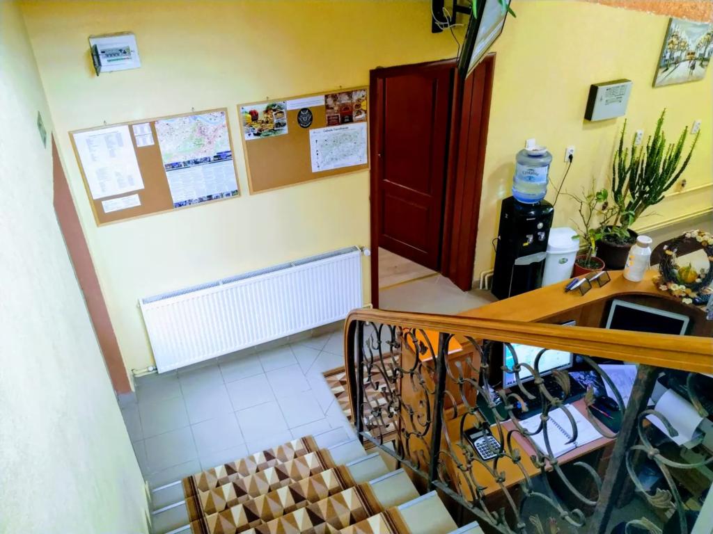 venesis-house-sighisoara-front-desk-info-panel-for-customers