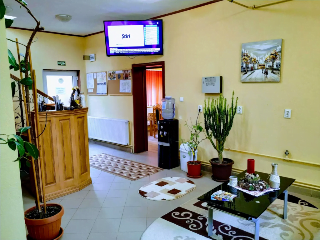 venesis-house-sighisoara-front-desk-led-tv-free-water-chill-place-to-rest