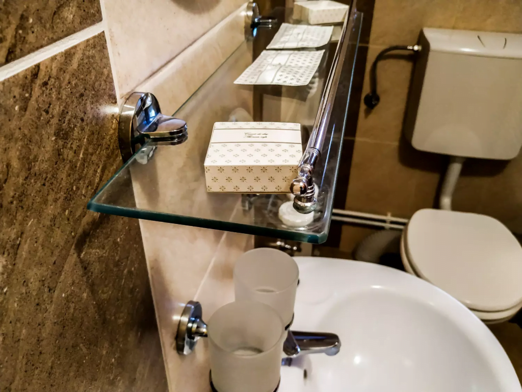 venesis-house-sighisoara-room-no-4-double-room-bathroom-sink-toilet-mirror-towels-toiletries-2