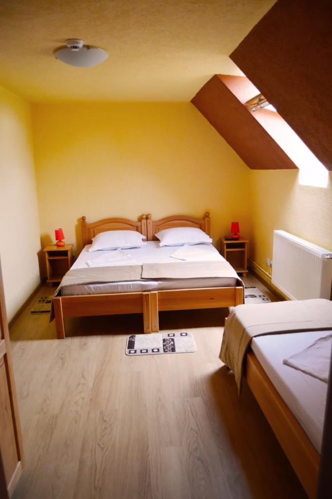 venesis-house-sighisoara-room-no-6-triple-room-3-single-beds